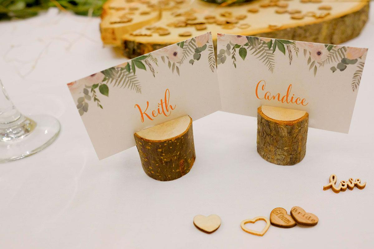 bride-groom-place-settings-on-wooden-log