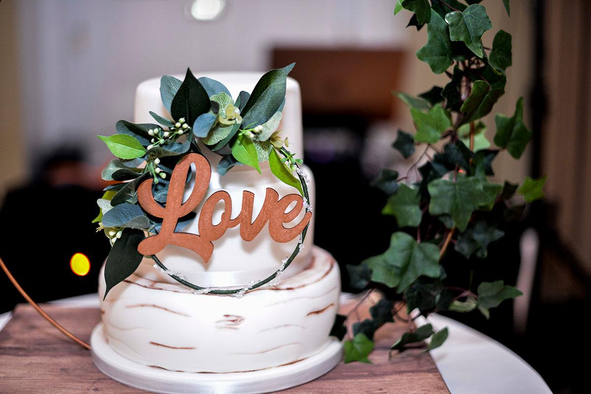 love-wedding-cake-with-round-foliage