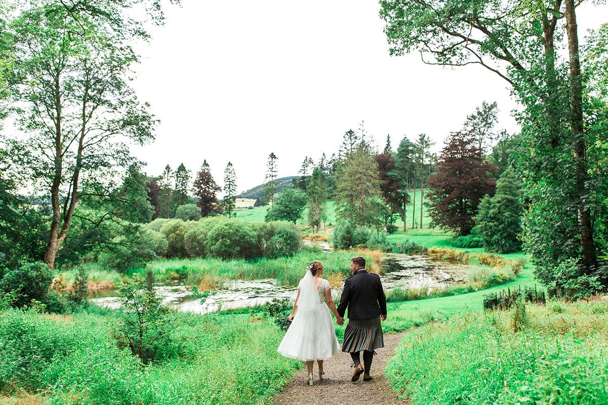 Hemera Visuals Dalswinton newlywed bride and groom walking