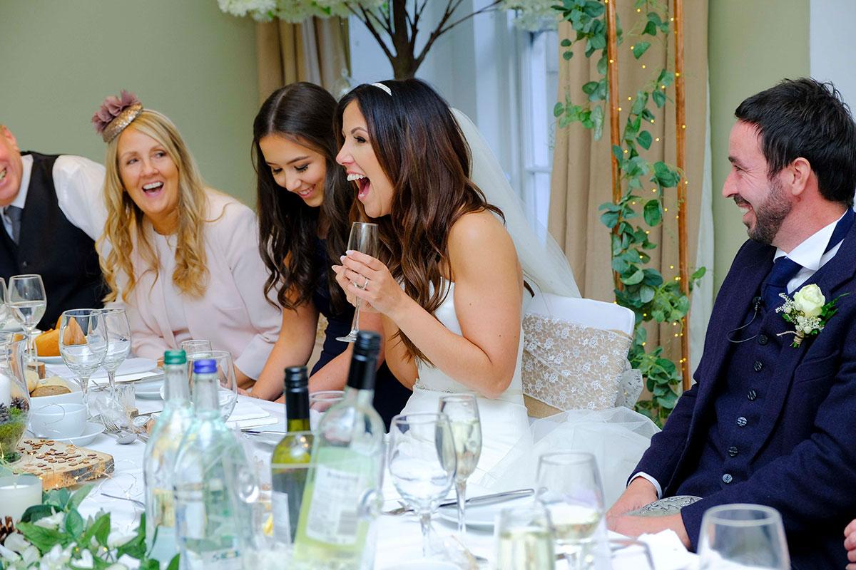 bride-groom-laughing-wedding-speeches-apex-hotel-edinburgh