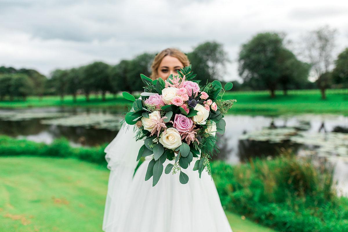 Hemera Visuals bride with bouquet by loch