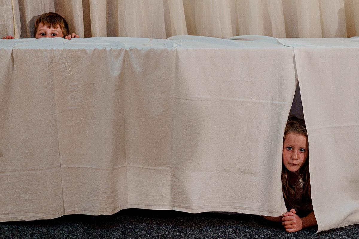 Isle-of-Lismore-Wedding-Photography-Barry-Robb-Oban-Corran-Halls-children-hiding-under-table