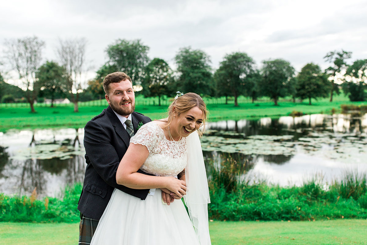 Hemera Visuals Dalswinton wedding bride and groom laughing by loch