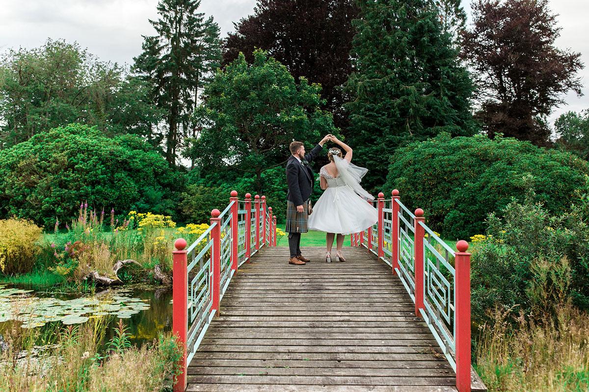 Hemera Visuals Dalswinton bride and groom dancing on bridge