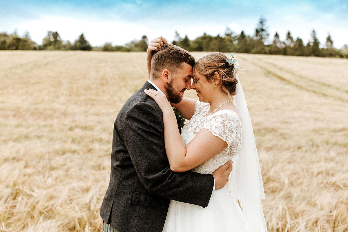 Hemera Visuals bride and groom in corn field