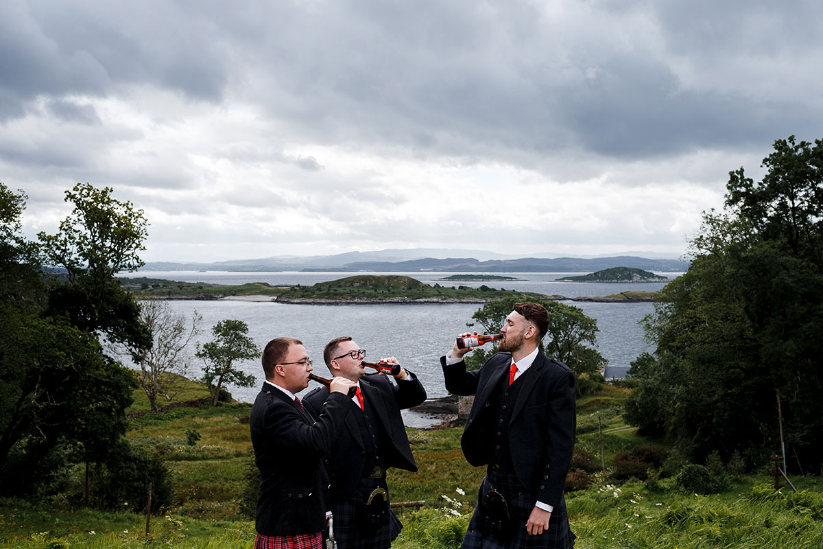 Isle-of-Lismore-Wedding-Photography-Barry-Robb-groomsmen-drinking