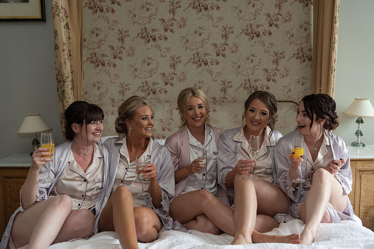 bride-bridesmaids-wearing-pyjamas-drinking-bucks-fizz