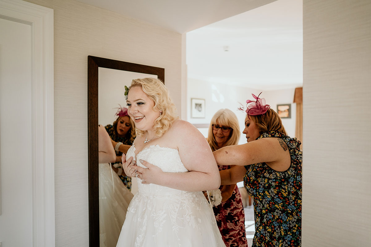 fife-wedding-victoria-photography-bride-getting-dressed-fairmont-st-andrews
