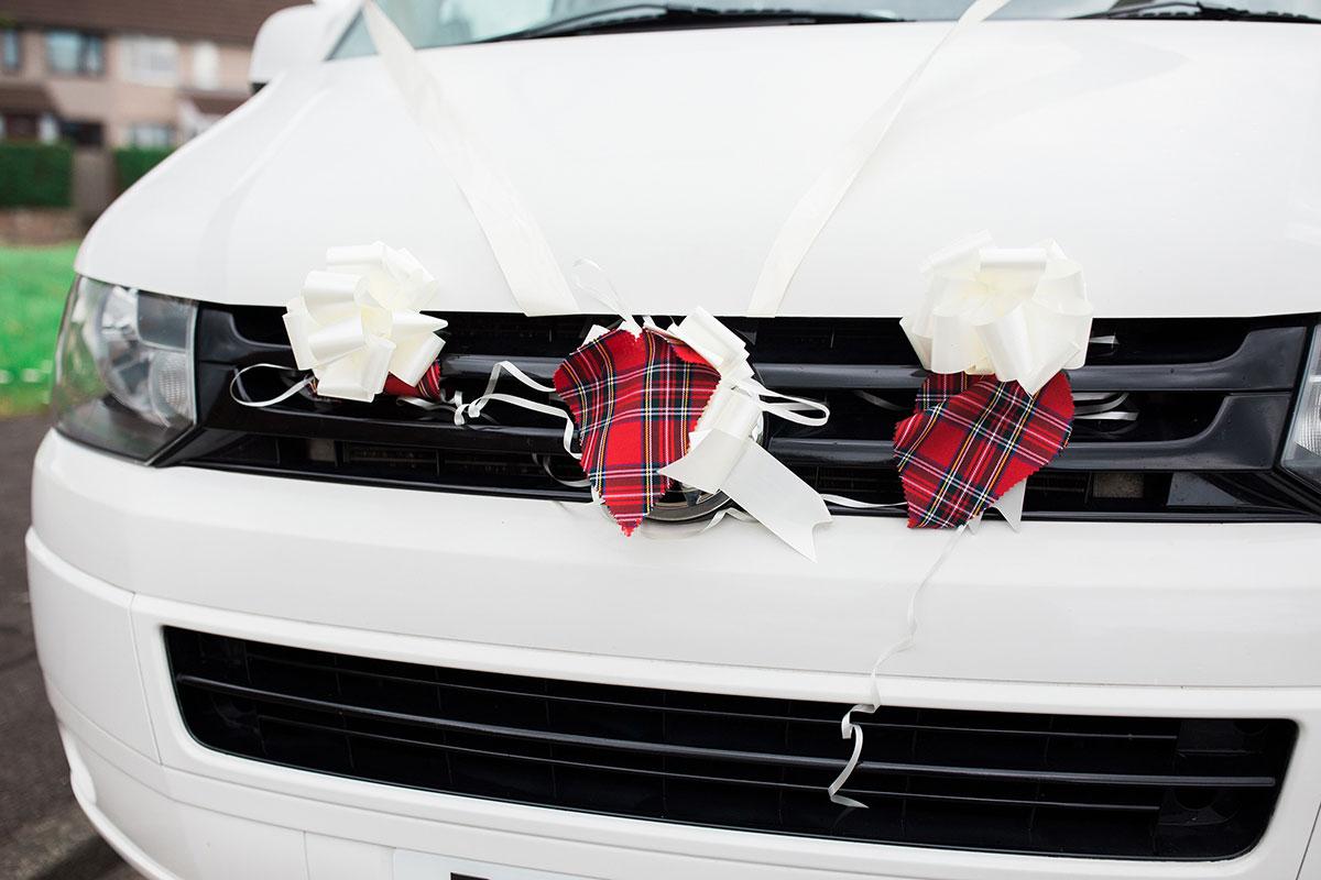 Hemera Visuals white wedding car with tartan decoration