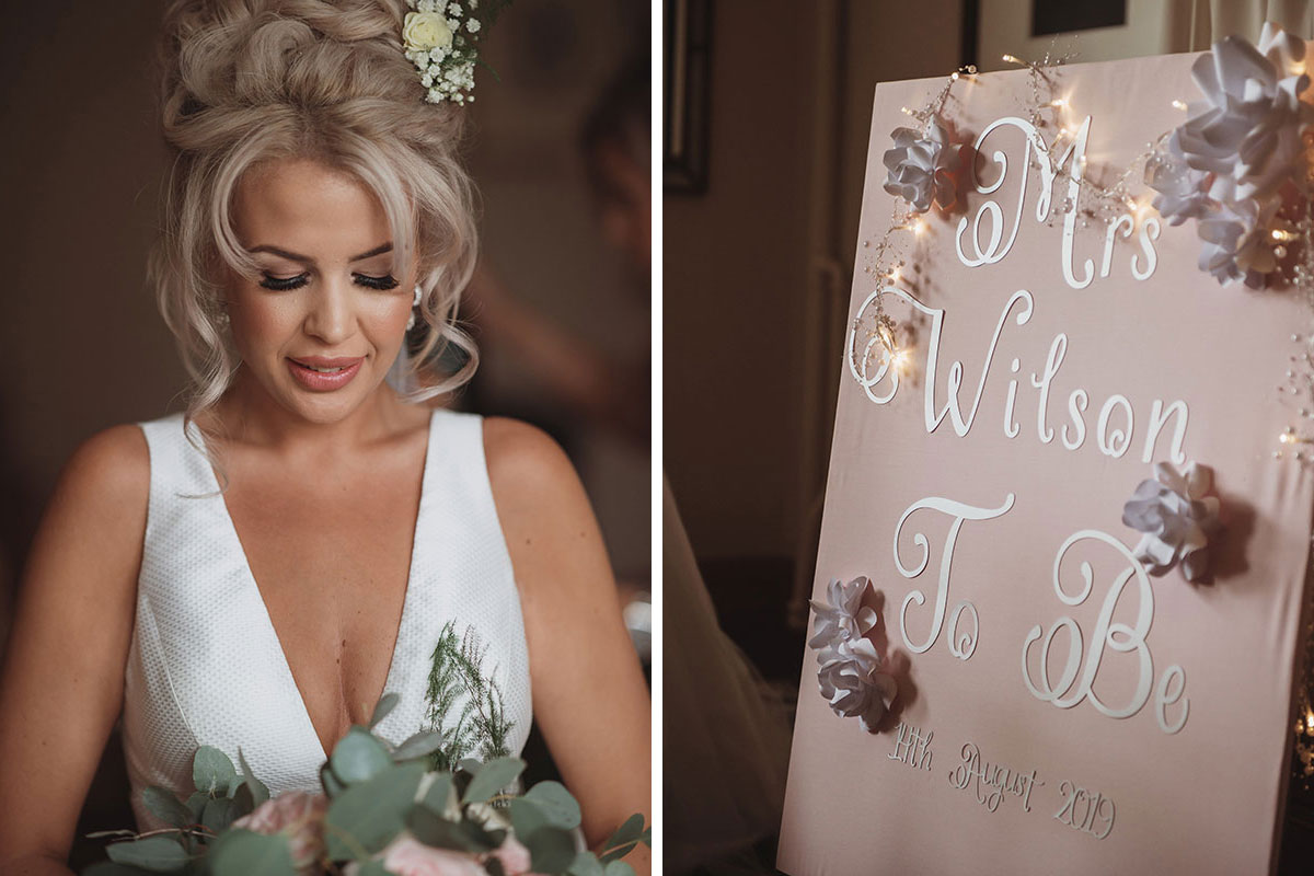Aboyne Photographics Meldrum House Aberdeen wedding venue bride looking at bouquet and mrs gift bag