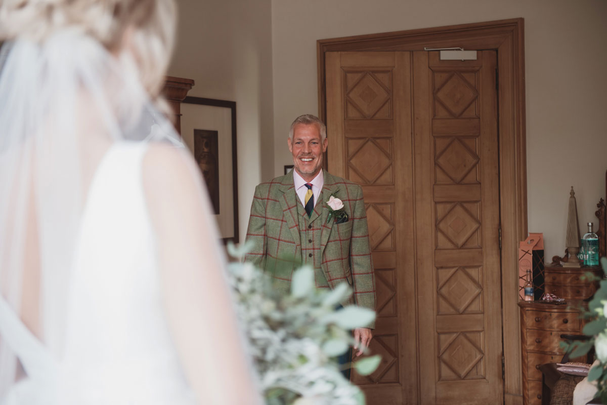 Aboyne Photographics Meldrum House Aberdeen wedding venue dad seeing bride for first time