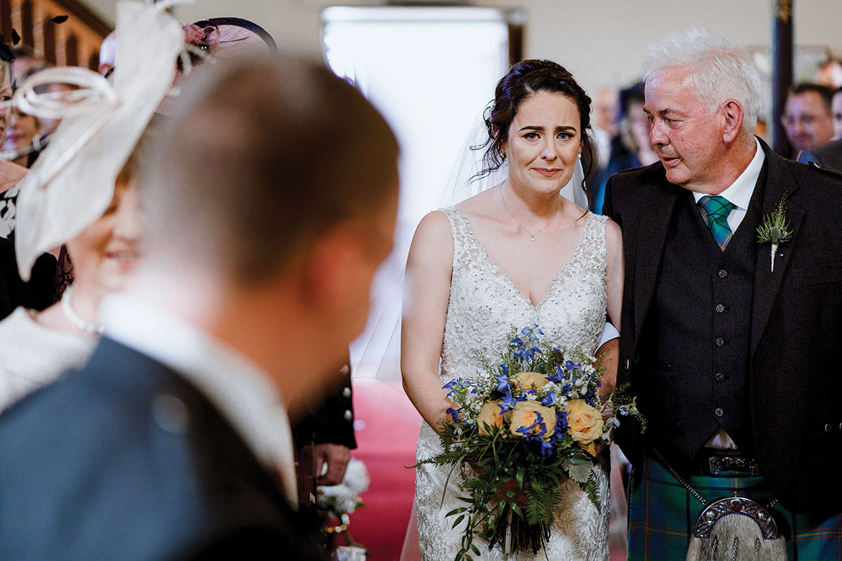 Isle-of-Lismore-Wedding-Photography-Barry-Robb-bride-walking-down-aisle-with-groom-at-bottom