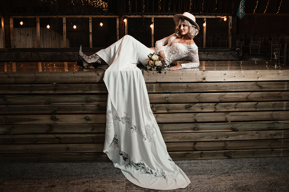 Amy King Bridal dress styled with boots and hat
