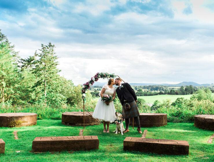 Hemera Visuals Dalswinton wedding couple kissing with dog