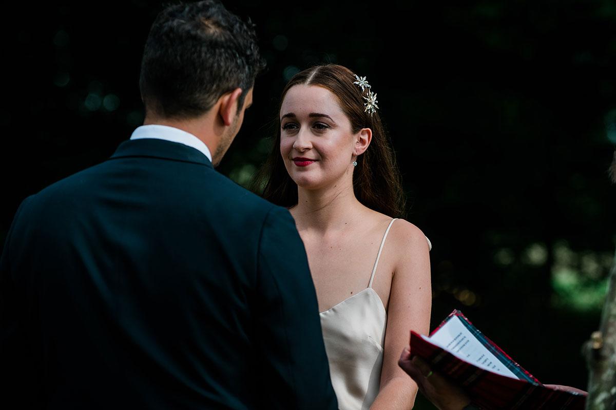 cormiston farm wedding mirrorbox photography bride during wedding ceremony