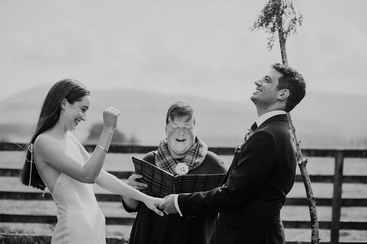 cormiston farm wedding mirrorbox photography bride and groom cheering just married outside