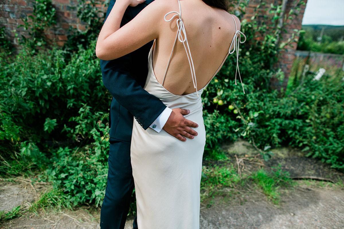 cormiston farm wedding mirrorbox photography groom hugging bride halfpenny london dress