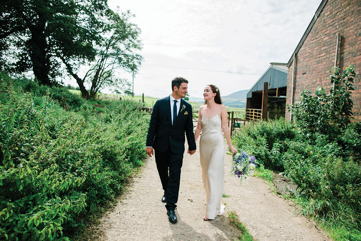 cormiston farm wedding mirrorbox photography bride and groom walking