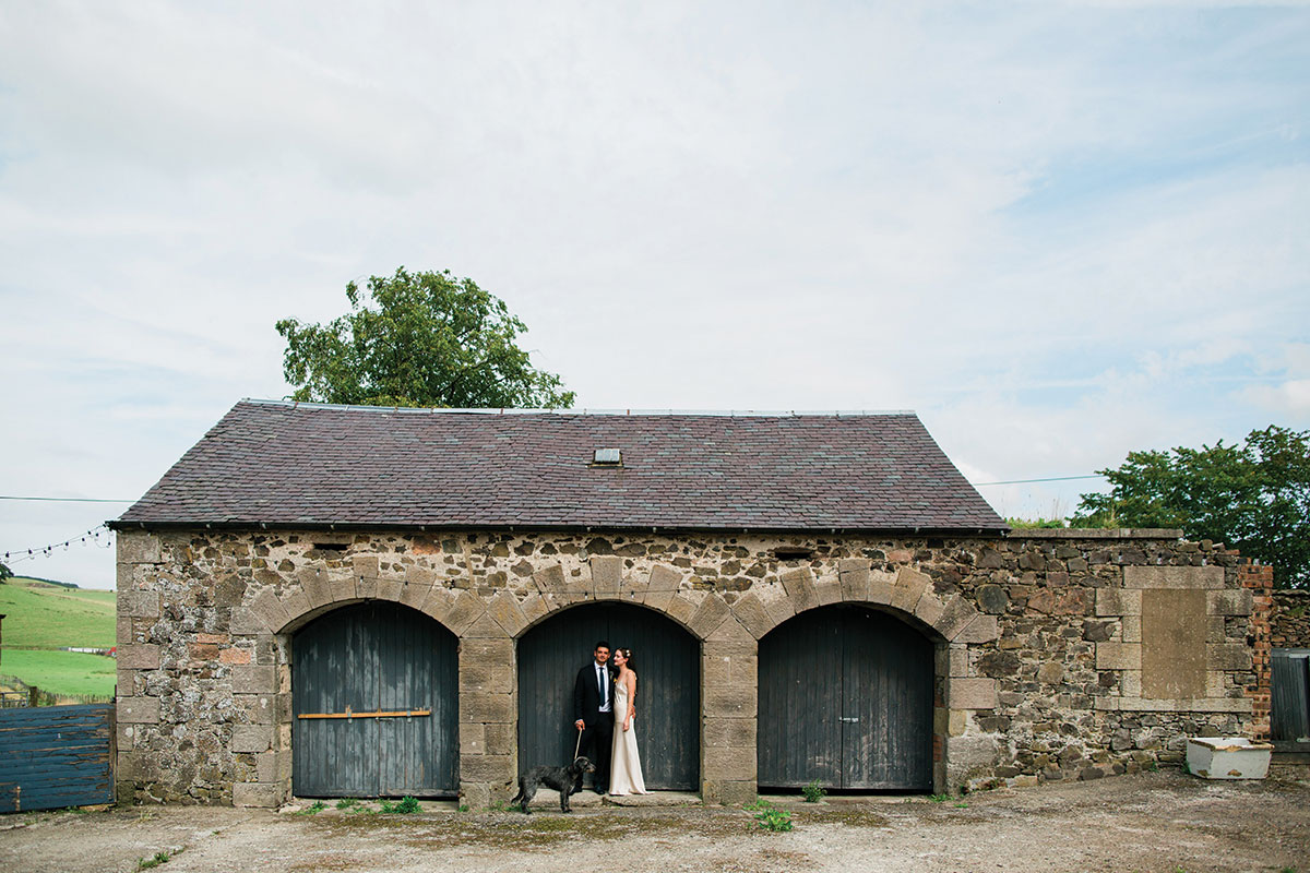cormiston farm wedding mirrorbox photography bride and groom with dog at shed