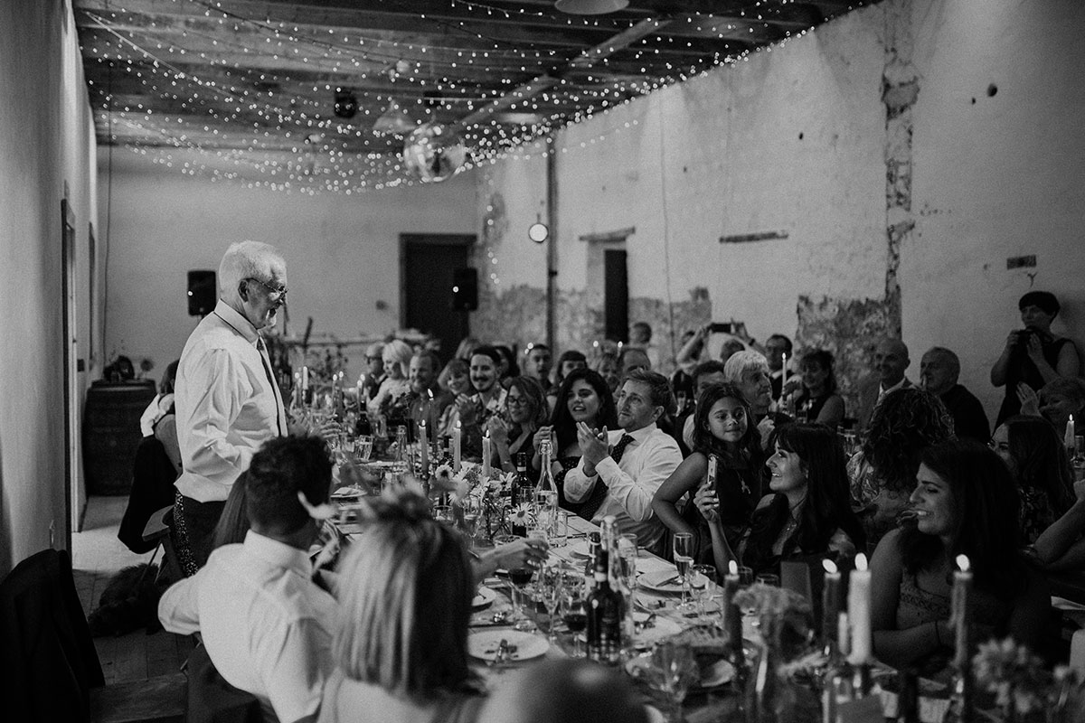 cormiston farm wedding mirrorbox photography father of bride making wedding speech guests looking on