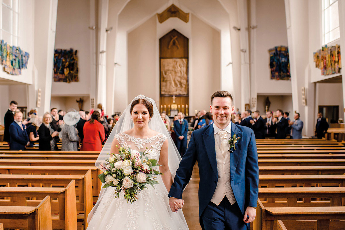 bride and groom with bouquet and buttonhole by Fleur & Blume