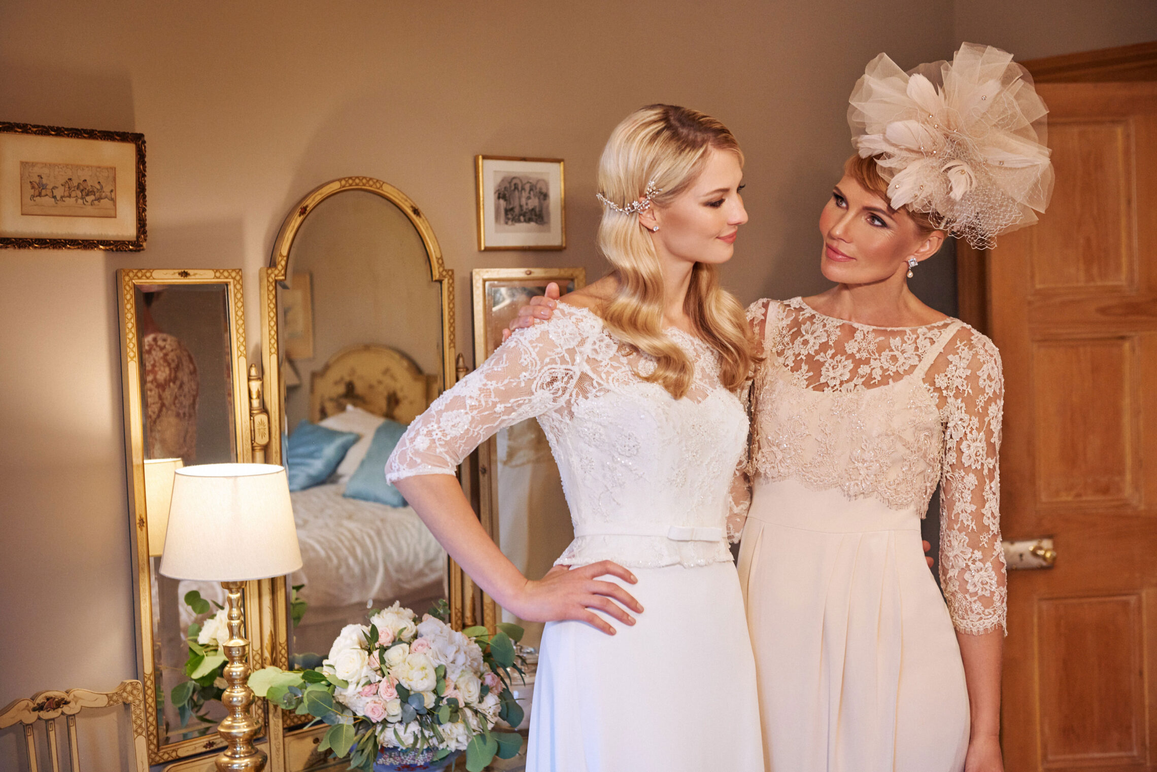 bride and mum wearing Joyce Young wedding and occasionwear dresses