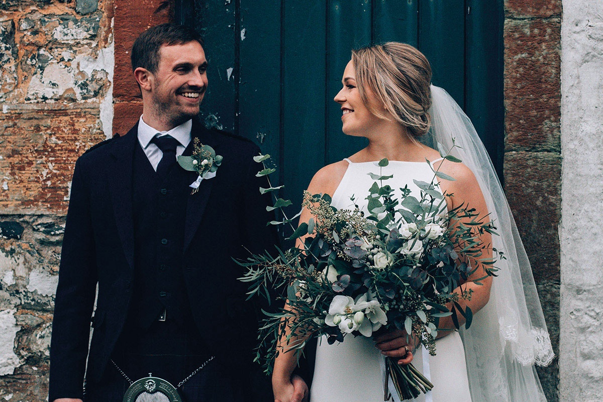 bride and groom with bouquet and buttonhole by To A Mountain Daisy
