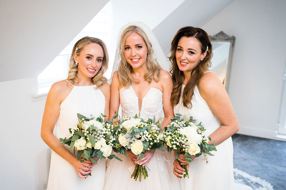 bridesmaids holding bouquets by Trudi Todd Flowers