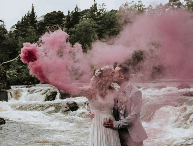 smoke bomb elopement bride and groom kissing by river affric