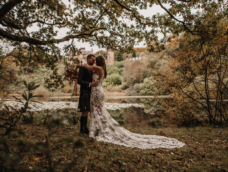 bride and groom in trees at Auchen Castle
