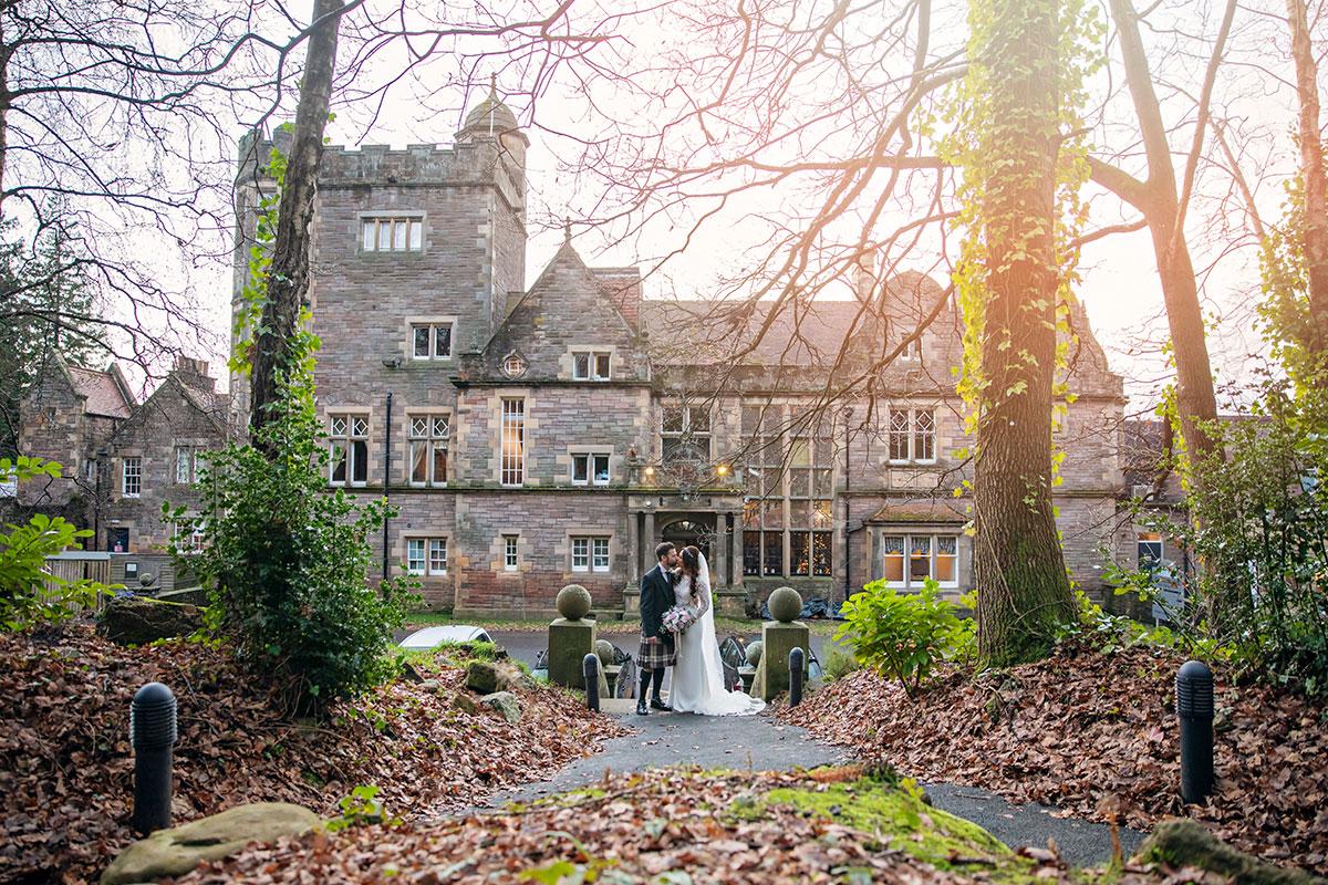bride and groom outside Inglewood House in December