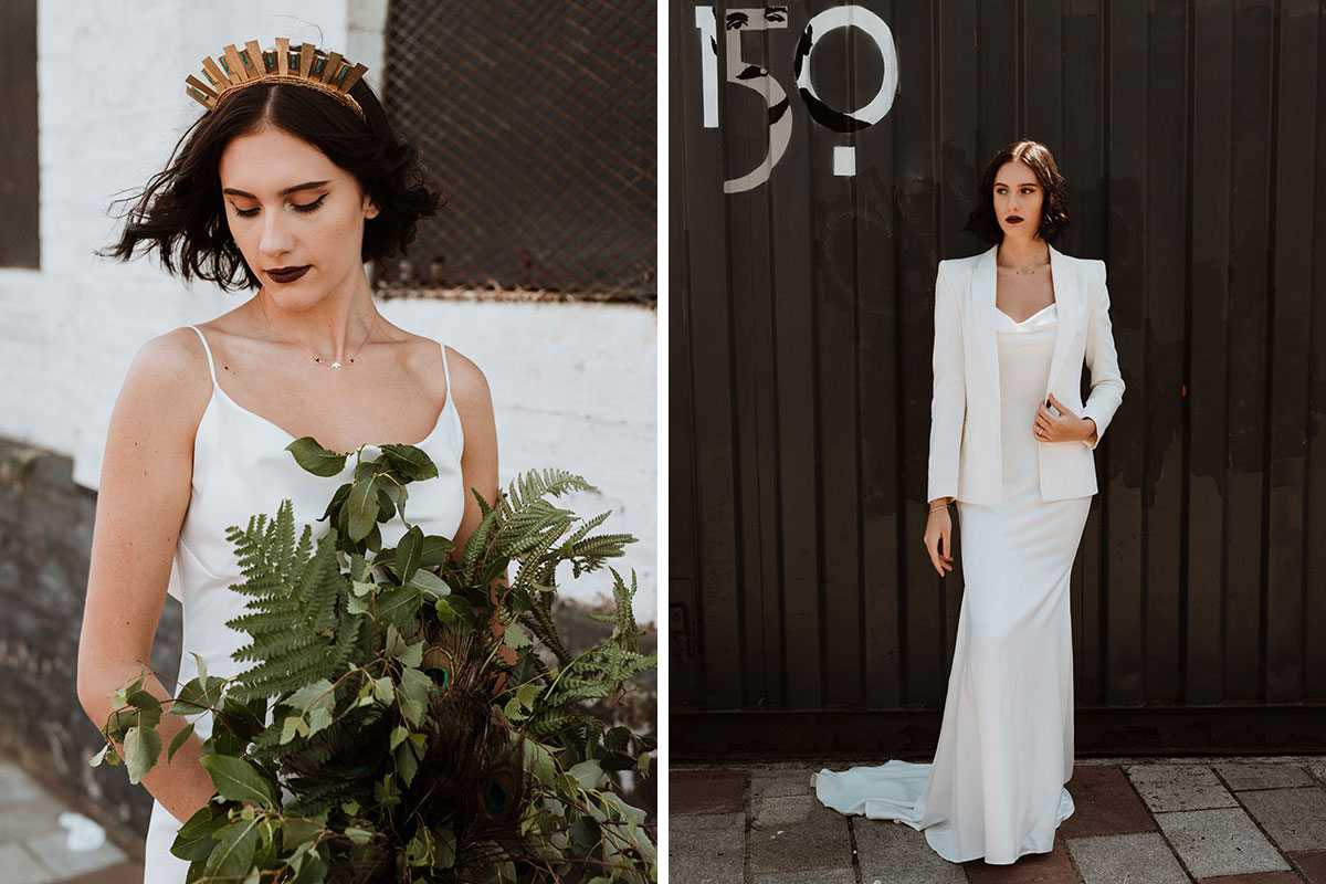 bride holding foliage bouquet and bride wearing blazer against black wooden wall