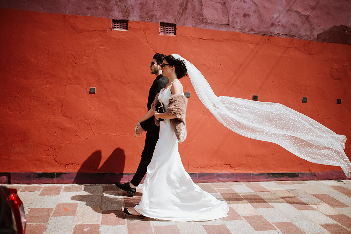 bride and groom walking on glasgow street