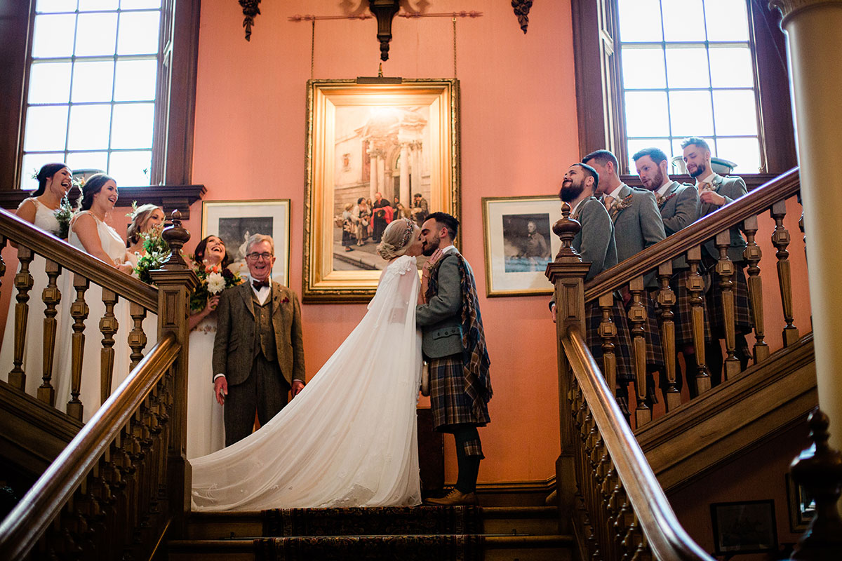 Wedding ceremony first kiss on staircase at Errol Park