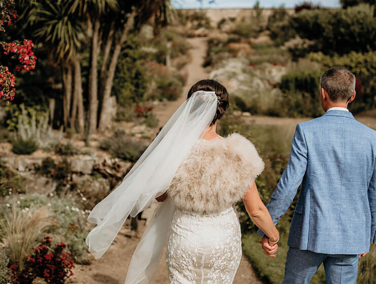 Cambo Estate bride and groom walking hand in hand