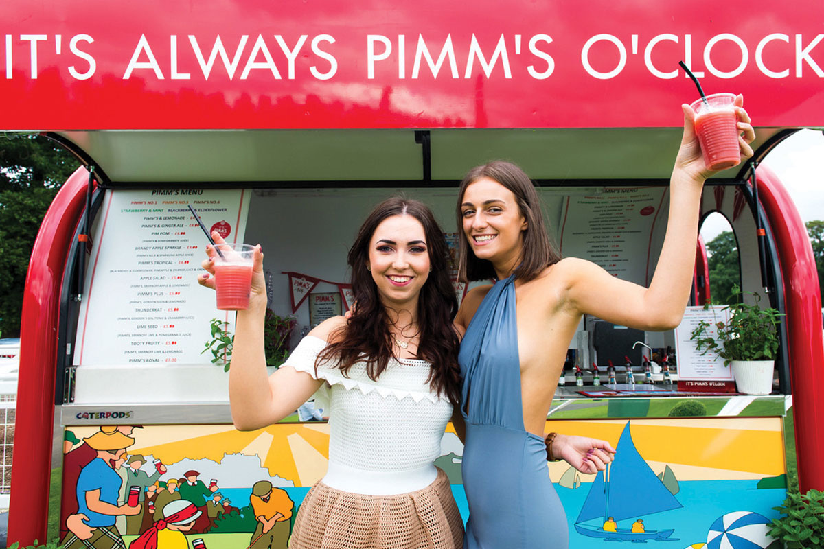 The Pimms Truck with two people drinking cocktails
