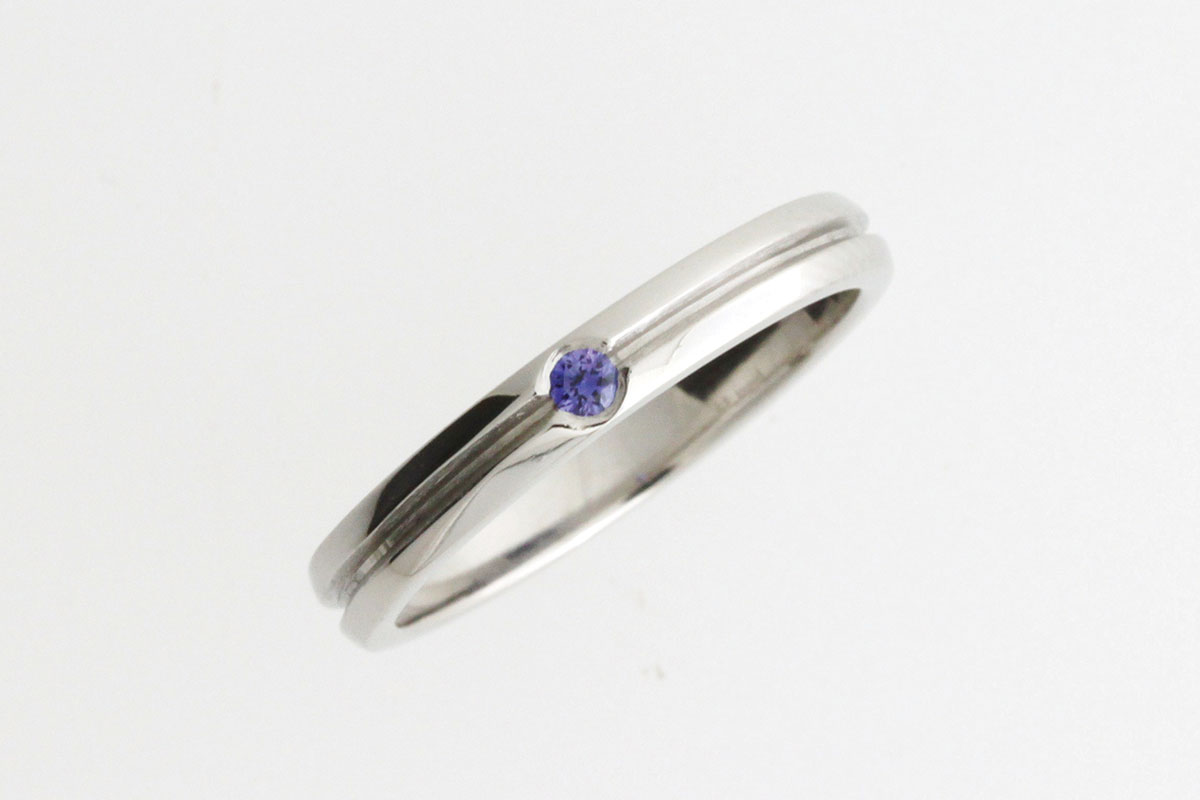 White gold ring with blue sapphire from Lava Jewellery
