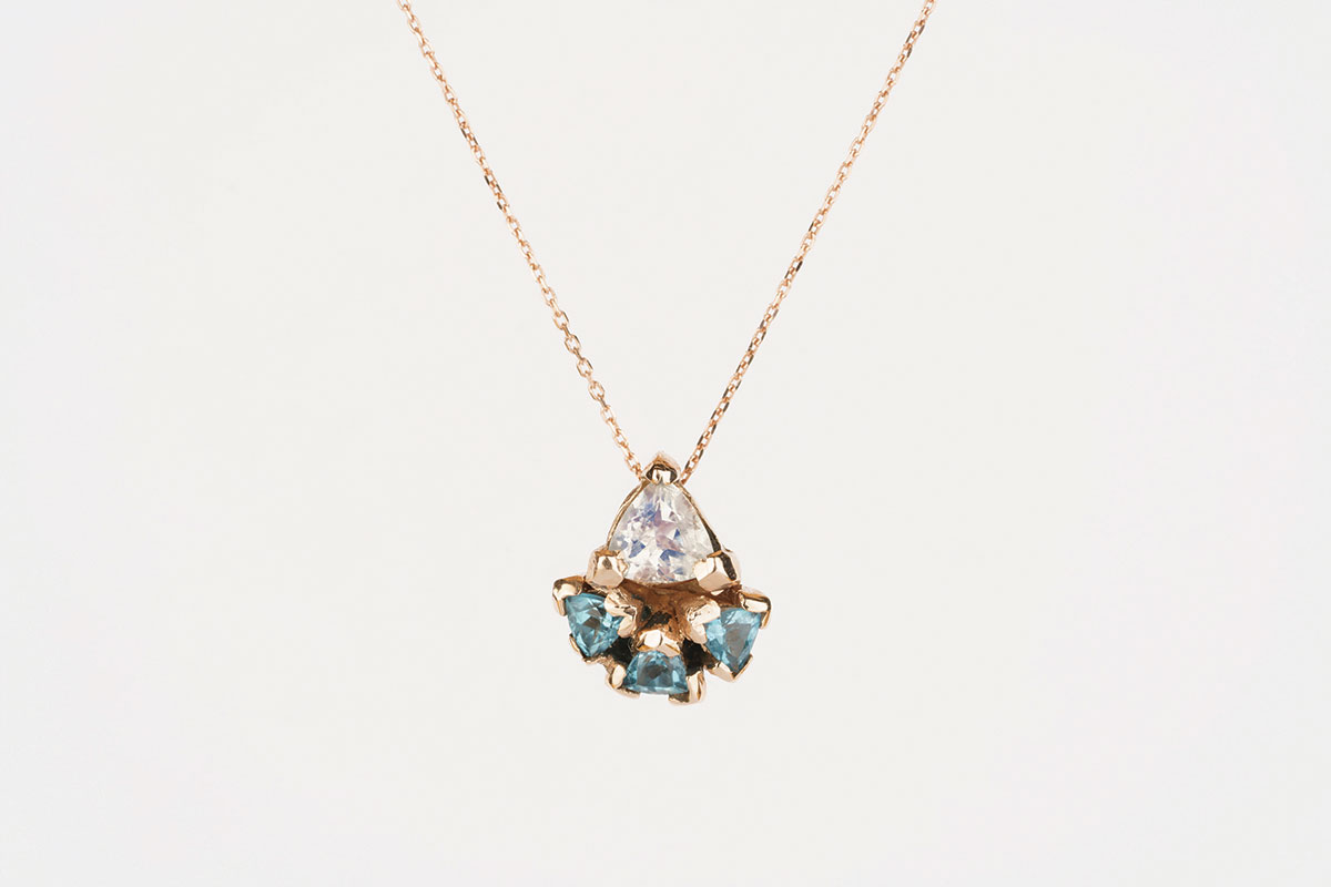 Rose gold pendant with blue topaz and moonstone by Katie Lees