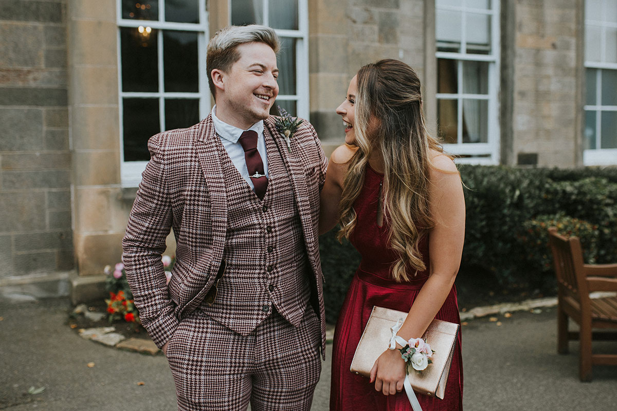 wedding guests laughing outside Norton House Hotel