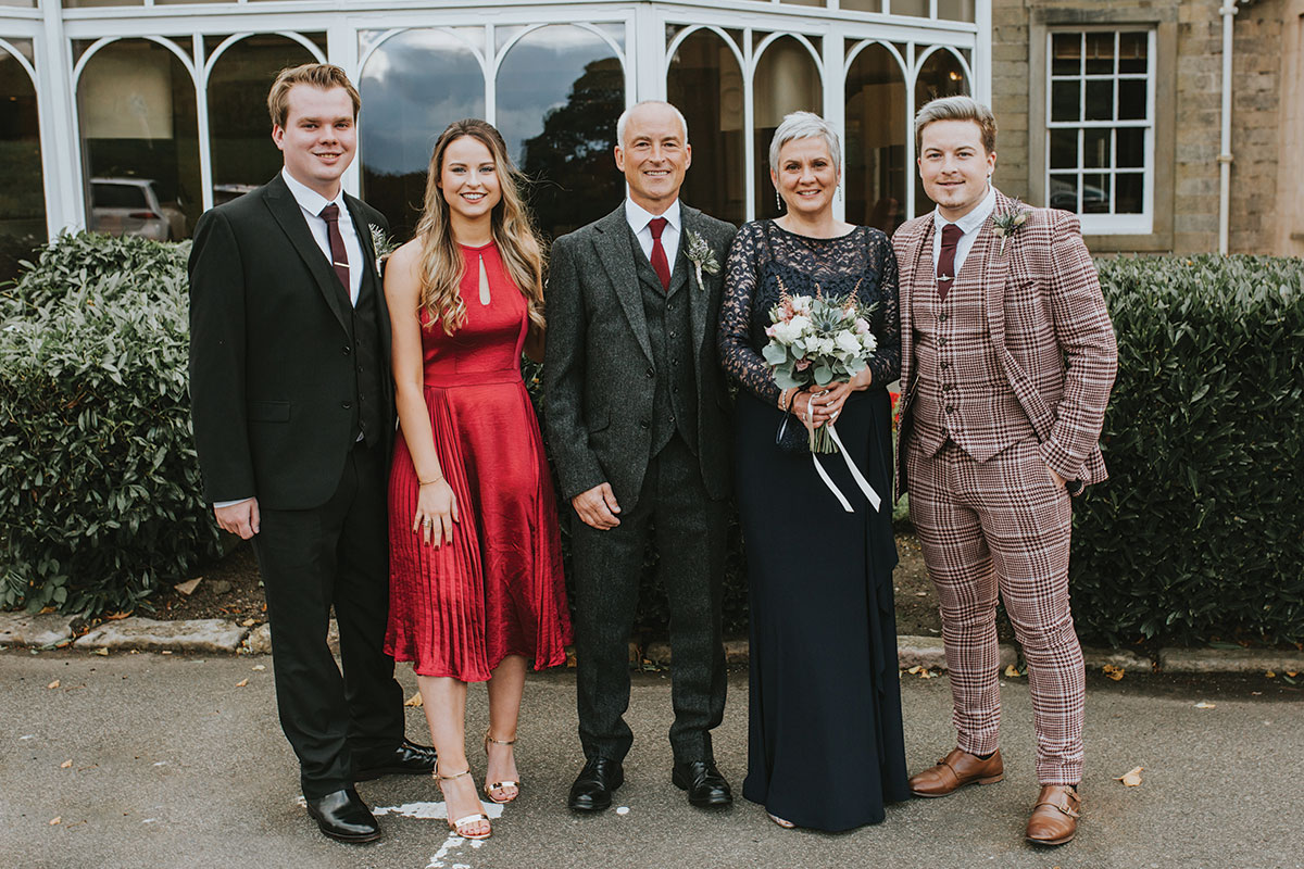 wedding guests with bride and groom outside Norton House Hotel