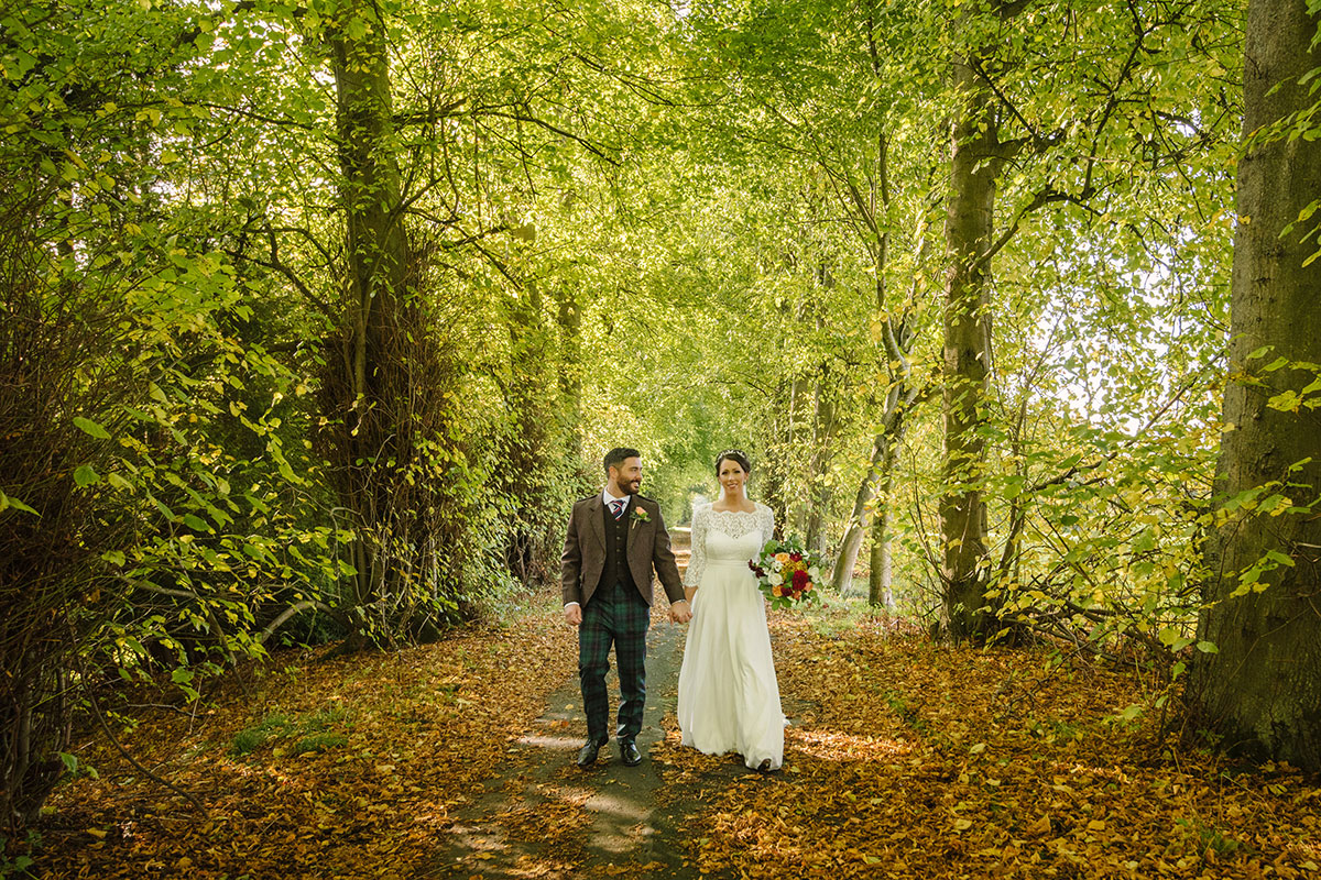 bride and groom in woodland at Hopetoun House