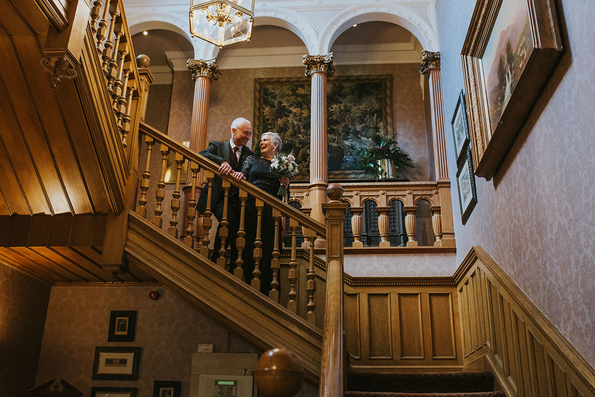 Older bride and groom on staircase at Norton House Hotel
