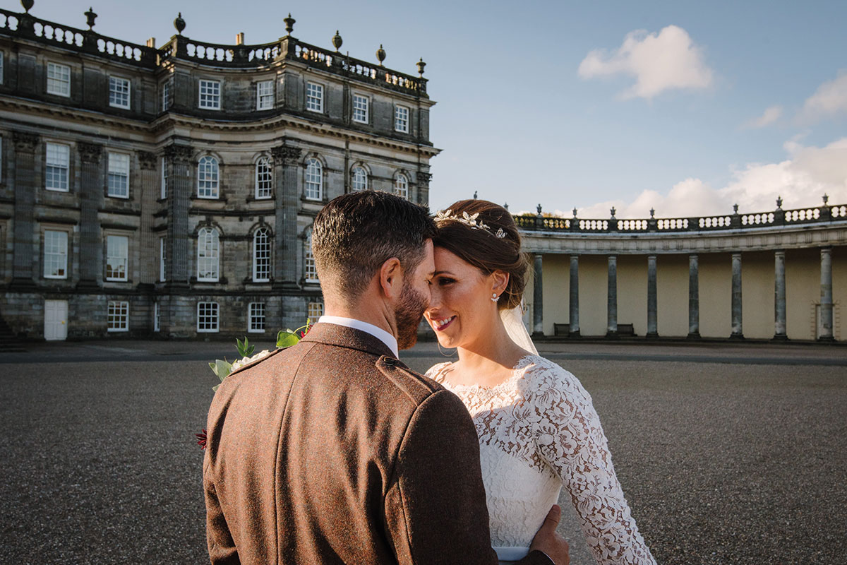 bride and groom nose to nose outside Hopetoun House