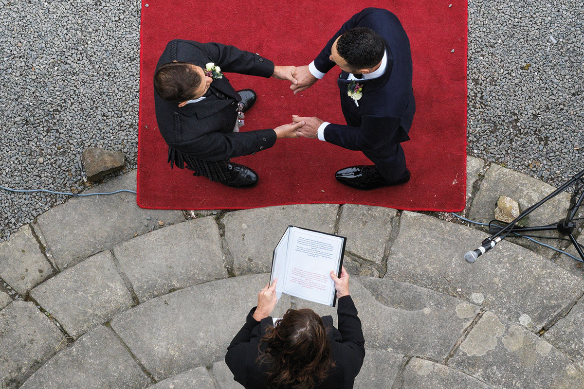Story of Love Photography two grooms ceremony Neidpath Castle aerial shot
