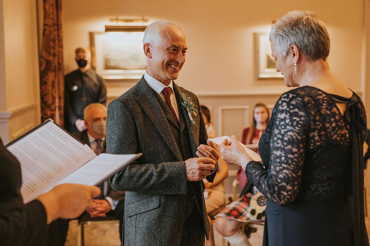 Older couple wedding ceremony Iris Art Photography