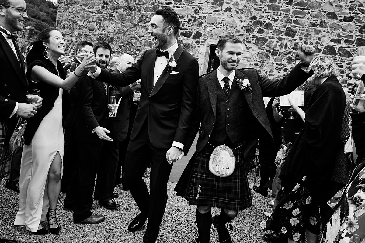 Story of Love Photography two grooms just married at Neidpath Castle