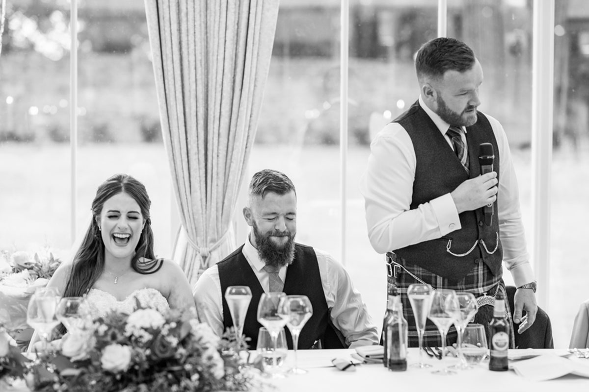CameraShy Photography laughing and cringing at best man's speech