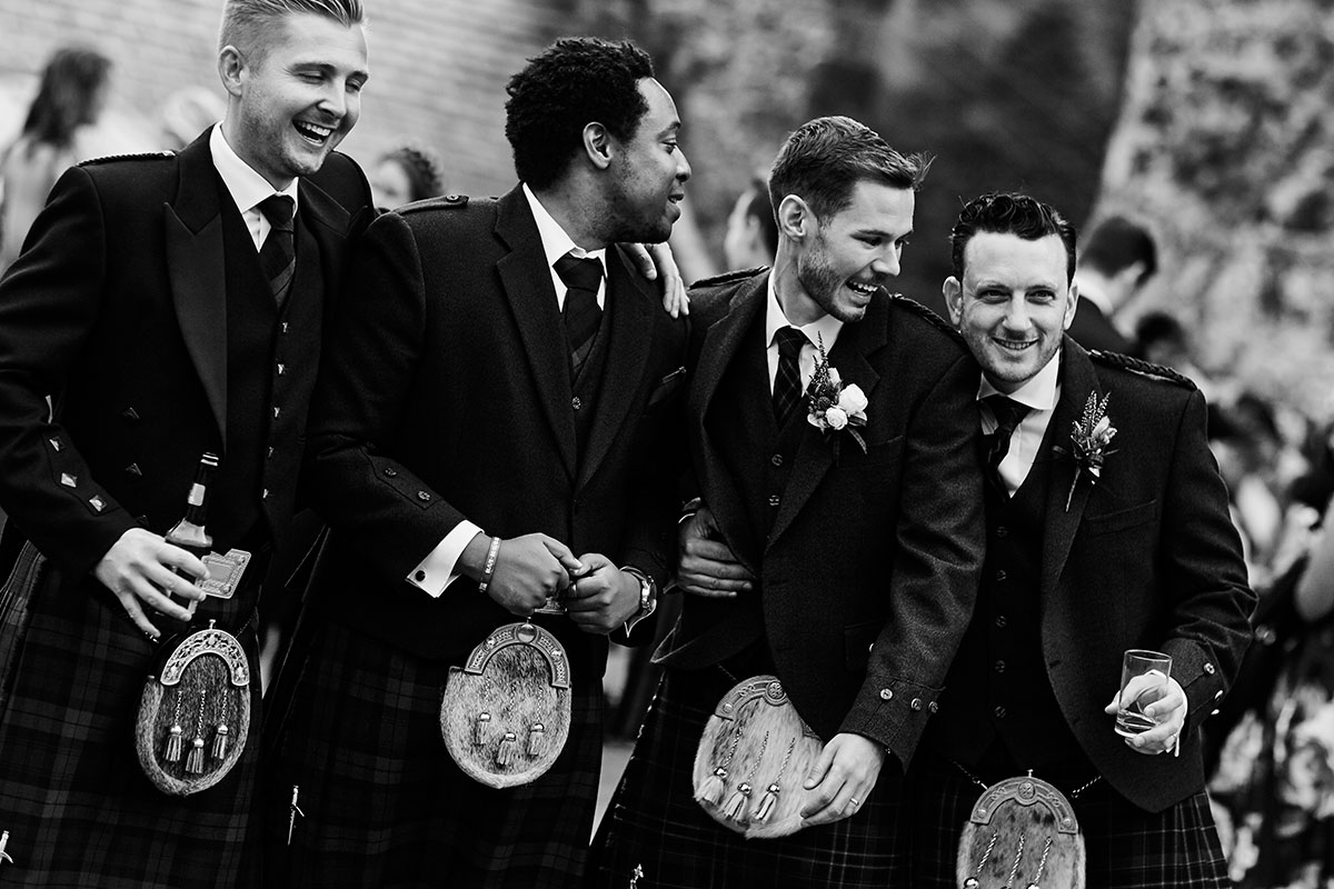 groom with 3 male wedding guests