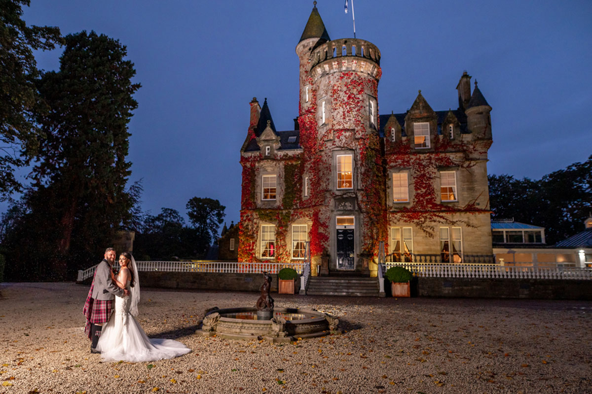 CameraShy Photography newlyweds outside Carlowrie Castle