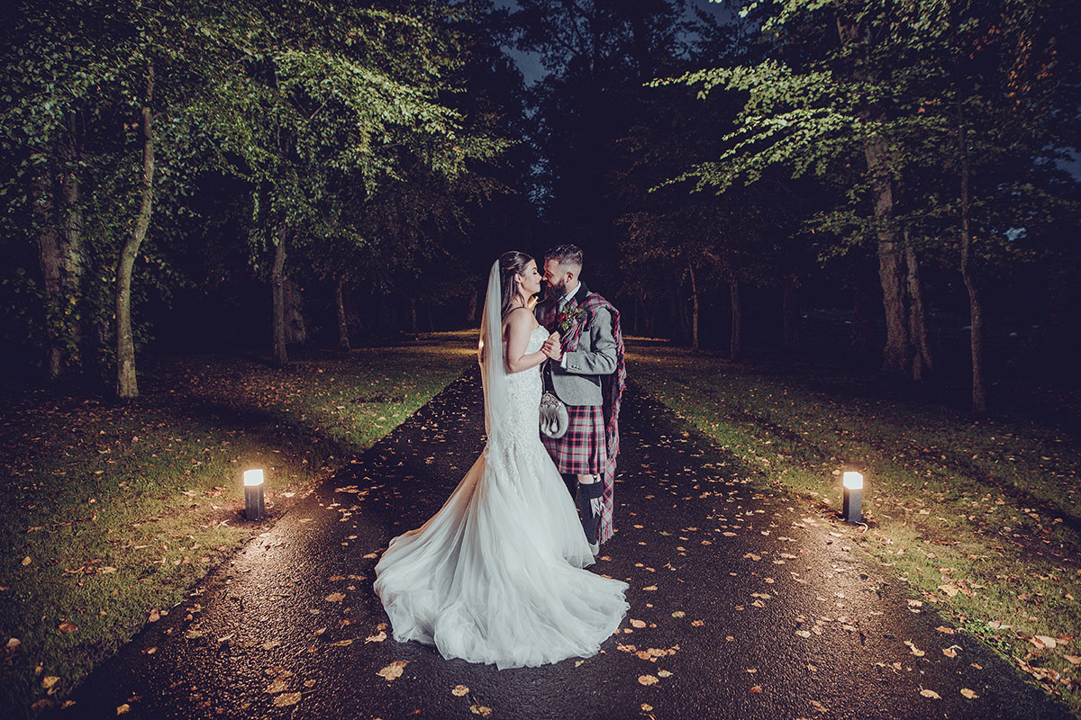 CameraShy Photography newlyweds in grounds of Carlowrie-Castle